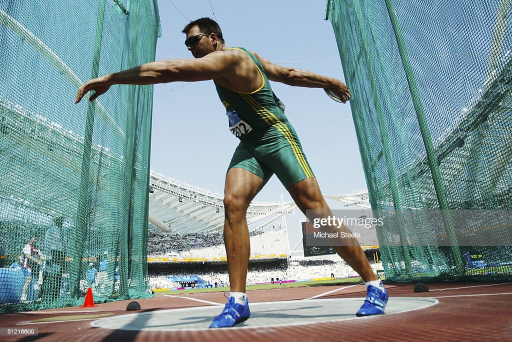 Frantz Kruger of South Africa competes in the men's discus qualifying round on August 21, 2004 during the Athens 2004 Summer Olympic Games at the Olympic Stadium in the Sports Complex in Athens, Greece.