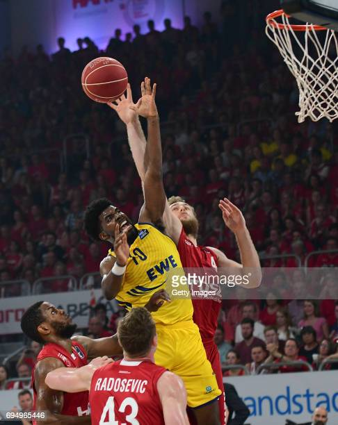 Frantz Massenat of Oldenburg goes to the hoop against Nicolo Melli and Darius Miller of Bamberg during game 3 of the 2017 BBL Finals at Brose Arena...