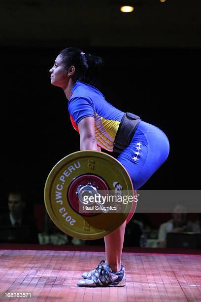 Franyolet Navarro of Venezuela A competes in the Women's 63 kg during day four of the 2013 Junior Weightlifting World Championship at Maria Angola...