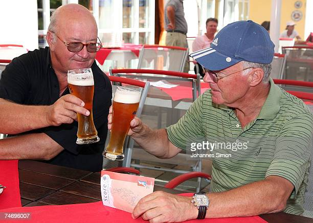 Franz Beckenbauer and Alois Hartl cheer after playing golf during the opening of Hartl Golf Resort on June 18 in Penning Germany