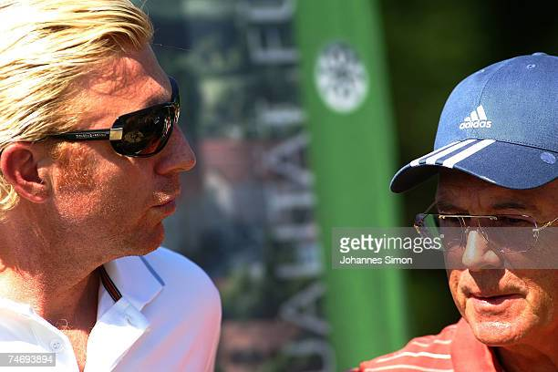 Franz Beckenbauer and Boris Becker chat together during the opening of Hartl Golf resort on June 17 in Penning Germany