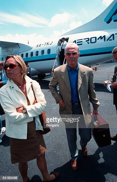 Franz Beckenbauer and his partner Sybille Beckenbauer arrive at the Airport on July 25 1990 in Guadalajara Mexico