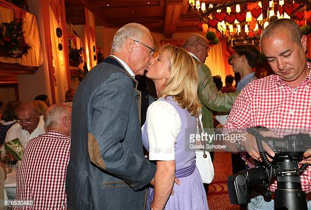 Franz Beckenbauer and his wife Heidi Beckenbauer kisses during a bavarian evening ahead of the Kaiser Cup 2016 on July 15 2016 in Bad Griesbach near...