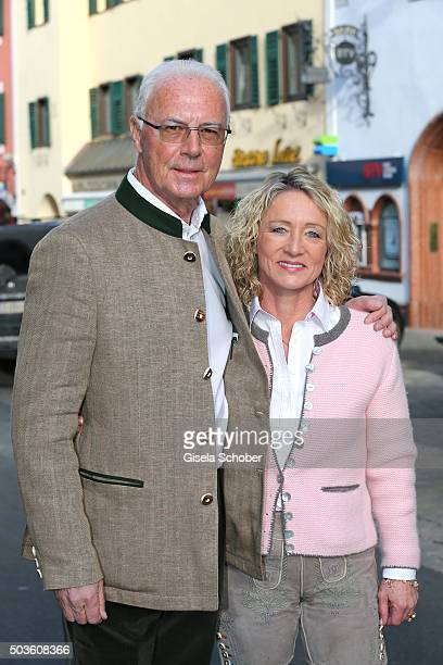 Franz Beckenbauer and his wife Heidi Beckenbauer wearing traditional leather trousers pose during the NeujahrsKarpfenessen at Hotel zur Tenne on...