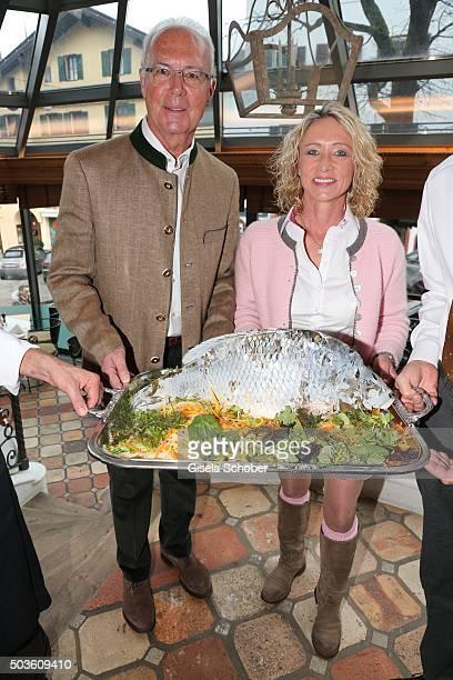 Franz Beckenbauer and his wife Heidi Beckenbauer with fish during the NeujahrsKarpfenessen at Hotel zur Tenne on January 6 2016 in Kitzbuehel Austria