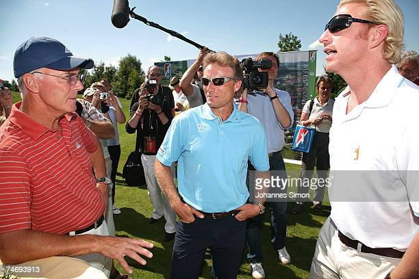 Franz Beckenbauer Bernhard Langer and Boris Becker chat together prior to the opening of Hartl Golf resort June 17 2007 in Penning Germany