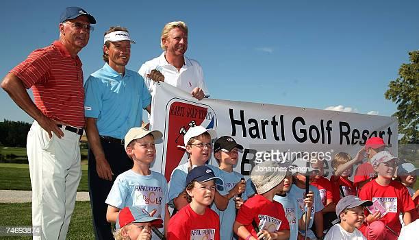 Franz Beckenbauer Bernhard Langer and Boris Becker pose with children during the opening of Hartl Golf resort on June 17 in Penning Germany