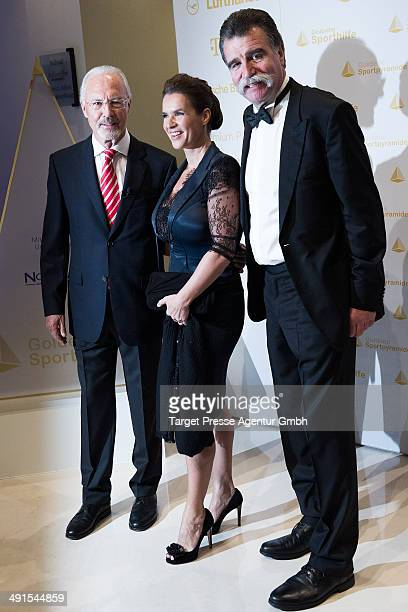 Franz Beckenbauer Katarina Witt and Heiner Brand attend the awarding of the 'Goldene Sportpyramide 2014' at Hotel Adlon on May 16 2014 in Berlin...