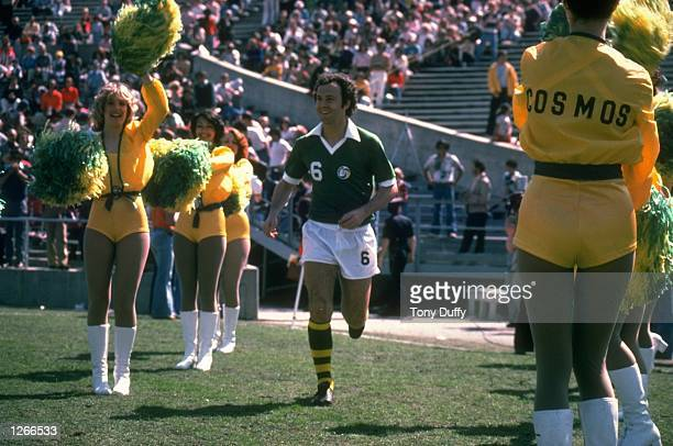 Franz Beckenbauer of New York Cosmos runs onto the pitch before a North American Soccer League match Mandatory Credit Tony Duffy/Allsport