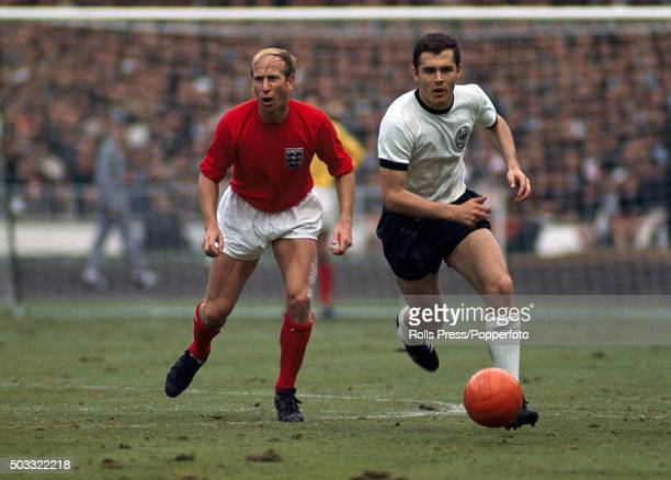 Franz Beckenbauer of West Germany moves away from Bobby Charlton of England during the FIFA World Cup Final between England and West Germany at...