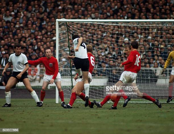 Franz Beckenbauer of West Germany shoots but the England defence holds firm during the FIFA World Cup Final between England and West Germany at...