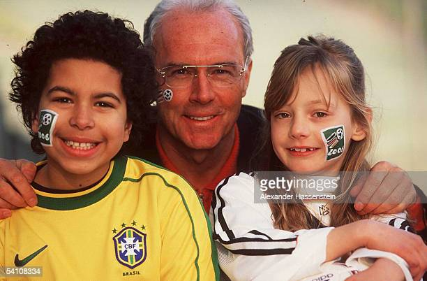 Franz Beckenbauer poses with children during the German Football Association candidature for the FIFA World Cup 2006 on January 25 1999 in Munich...