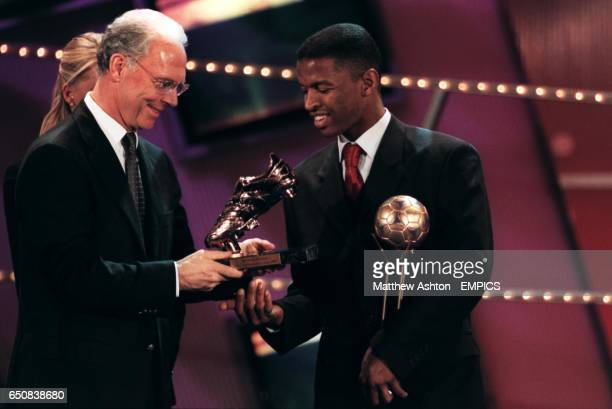 LR Franz Beckenbauer presents Saudi Arabia's Al Otaibi Marzouk with his top scorer Adidas Bronze Shoe for the FIFA Confederations Cup in Mexico '99