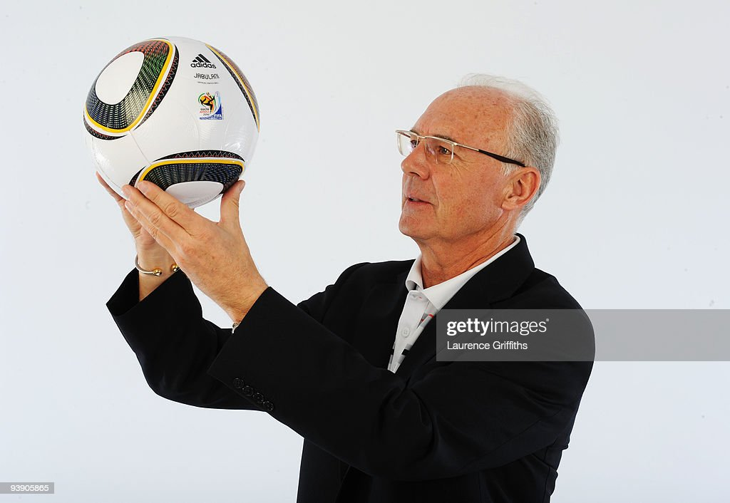 Franz Beckenbauer presents the official match ball for the FIFA World Cup 2010 on December 4, 2009 in Cape Town, South Africa.