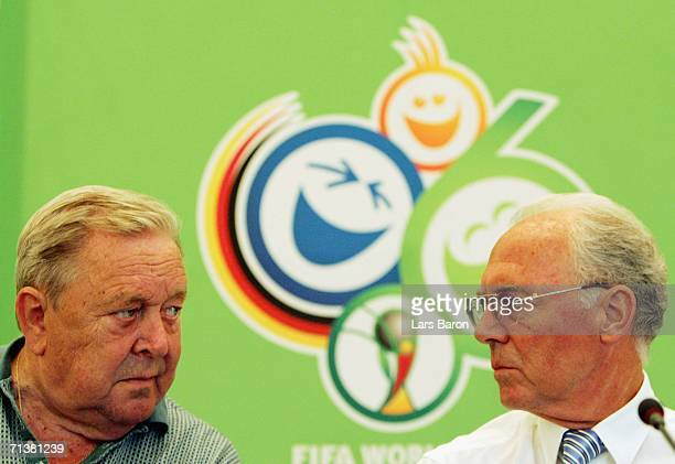 Franz Beckenbauer president of the 2006 FIFA World Cup Organizing Committee speaks to Lennart Johansson FIFA VicePresident during a press conference...