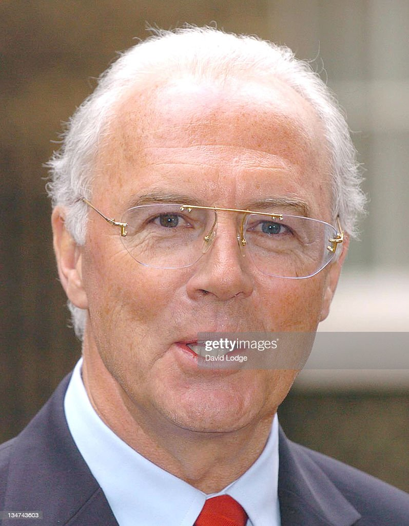 Franz Beckenbauer speaks to the media as he leaves 10 Downing Street in central London, February 2, 2006, after a meeting with Prime Minister Tony Blair and other guests from the world of sport, politics and the media to discuss preparations for the World Cup 2006 held in Germany.