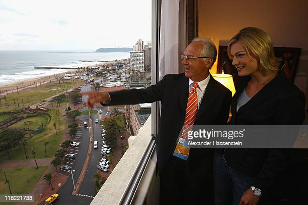 Franz Beckenbauer talks Alpine Olympic Champion Maria HoefelRiesch on a hotel window at Durban Beach prior a press conference on July 5 2011 in...