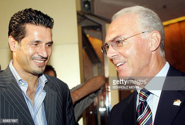 Franz Beckenbauer the head of the organising committee for the 2006 World Cup finals in Germany chats with Iran's national soccer team captain Ali...