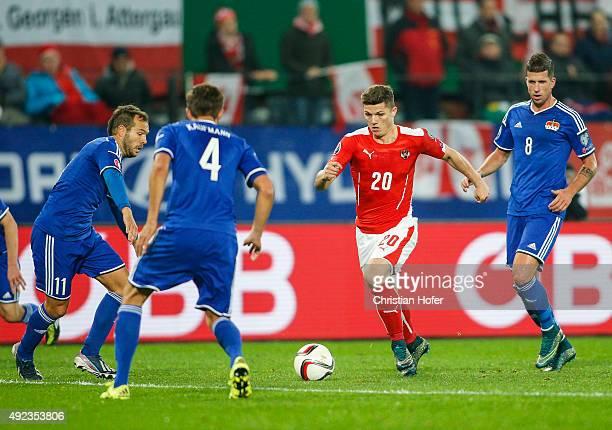 Franz Burgmeier Daniel Kaufmann and Sandro Wieser of Liechtenstein compete for the ball with Marcel Sabitzer of Austria during the UEFA EURO 2016...