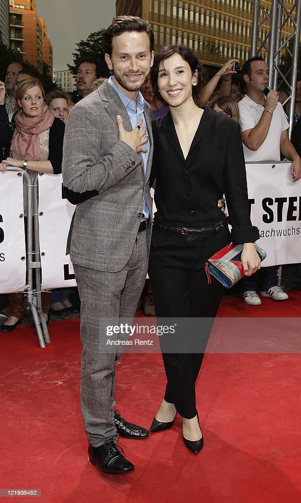 Franz Dinda and Sibel Kekilli attend the First Steps Award 2011 at the Theater Am Potsdamer Platz on August 23, 2011 in Berlin, Germany.