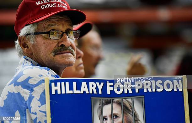 Franz Grimm of Las Vegas displays support for Republican presidential nominee Donald Trump at a getoutthevote rally at Ahern Manufacturing on...