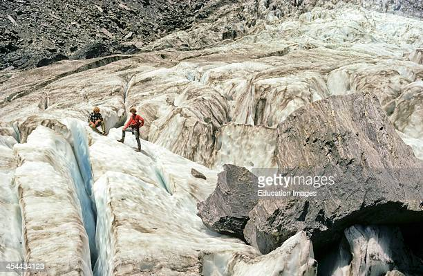 Franz Josef Glacier with dangerous crevasses Note two huge mica schist rocks transported to eventually become erratics West CoaSt New Zealand