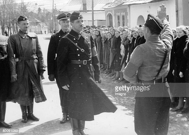 Franz Karmasin in GrossLomnitz A lokal leader of the german party gives report Photograph 04 1940 [Propagandawelle der 'deutschen Partei' in der...