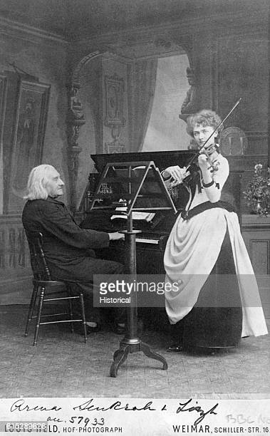 Franz Liszt was a Hungarian composer and pianist In this photo taken in a photographer's studio he accompanies a female violinist on the piano