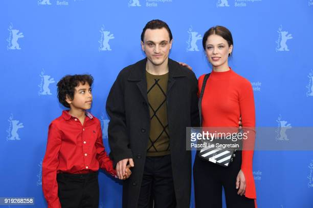 Franz Rogowski Lilien Batman and Paula Beer pose at the 'Transit' photo call during the 68th Berlinale International Film Festival Berlin at Grand...