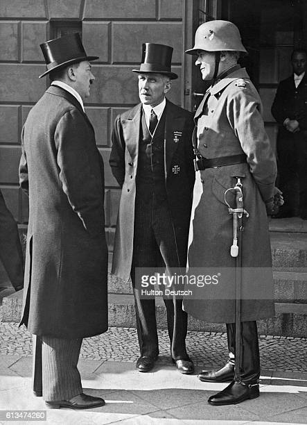 Franz von Papen, German politician , with Adolf Hitler and von Blomberg on a day of general mourning on 12th March 1933 for German soldiers killed in...