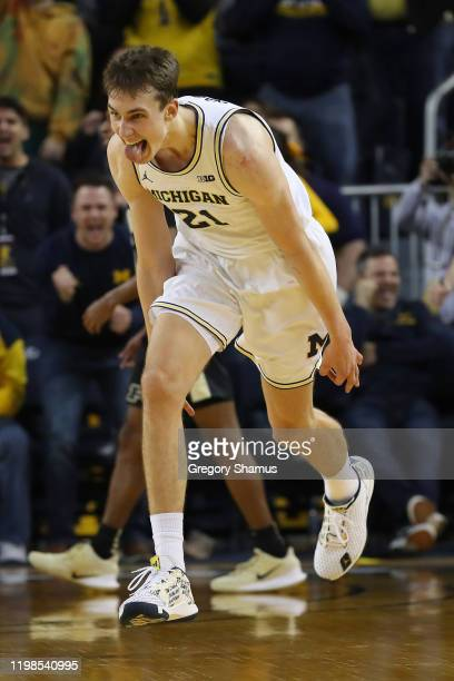 Franz Wagner of the Michigan Wolverines reacts to his three point basket in the second overtime against the Purdue Boilermakers at Crisler Arena on...