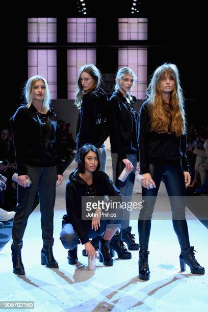 Franzi Mueller Anuthida Ploypetch and other models on the runway at the Riani show during the MBFW Berlin January 2018 at ewerk on January 16 2018 in...