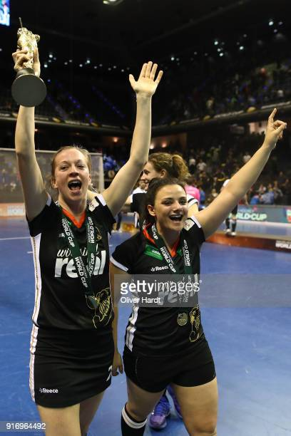 Franzisca Hauke and Rosa Kruger of Germany celebrate with the trophy after the Women Gold Medal Indoor Hockey World Cup Berlin Final Day mtach...