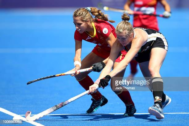 Franzisca Hauke of Germany and Cristina Guinea of Spain compete for the ball during the FIH Womens Hockey World Cup Pool C game between Spain and...
