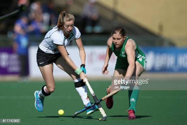 Franzisca Hauke of Germany and Kathryn Mullan of Ireland battle for possession during day 2 of the FIH Hockey World League Semi Finals Pool A match...