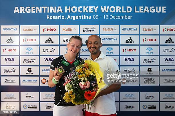 Franzisca Hauke of Germany receives a bunch of flowers and a commemorative ball after reaching 100 caps during Day 2 of the Hockey World League Final...