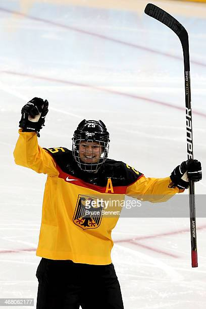 Franziska Busch of Germany celebrates after scoring a goal in the second period against Yulia Leskina of Russia during the Women's Ice Hockey...