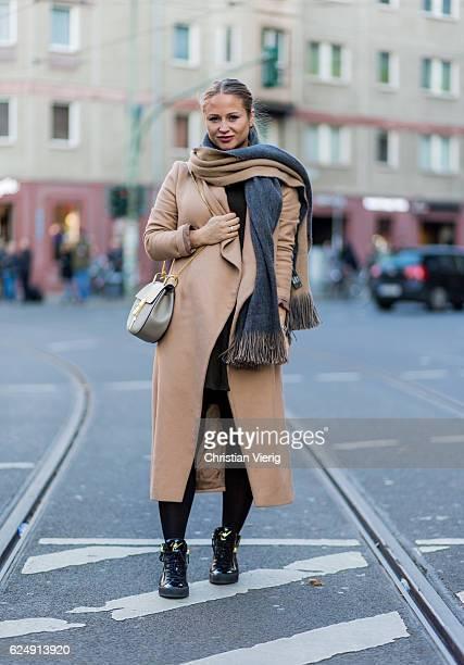 Franziska Esswein wearing a Chloe bag a beige wool coat beige grey scarf black sneaker shoes on November 21 2016 in Berlin Germany