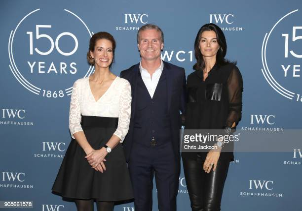 Franziska Gsell David Coulthard and Karen Minier visit the IWC booth during the Maison's launch of its Jubilee Collection at the Salon International...