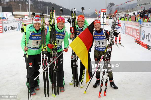 Franziska Hildebrand, Nadine Horchler, Maren Hammerschmidt and Denise Herrmann of Germany celebrates after winning the Women's 4x6km relay during the...