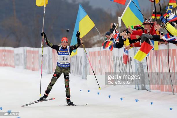 Franziska Hildebrand of Germany celebrates after winning the Women's 4x6km relay during the BMW IBU World Cup Biathlon 2017 test event for...