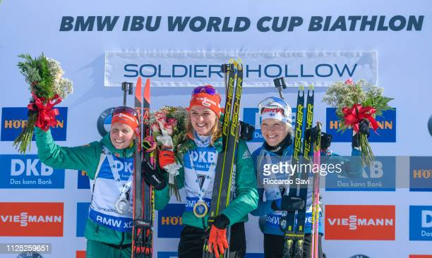 Franziska Hildebrand of Germany Denise Herrmann of Germany Kaisa Makarainen of Finland celebrate during the Women's 10 KM Pursuit Competition of the...