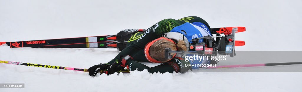 Franziska Hildebrand of Germany falls down during the women's 7,5 km sprint event at the IBU Biathlon World Cup in Oberhof, central Germany, on January 4, 2018. The event runs until January 7, 2018. / AFP PHOTO / DPA / Martin Schutt / Germany OUT