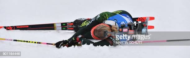Franziska Hildebrand of Germany falls down during the women's 7,5 km sprint event at the IBU Biathlon World Cup in Oberhof, central Germany, on...