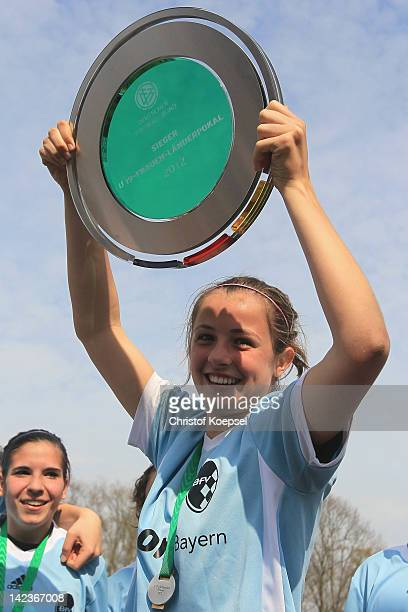 Franziska Hutter of Bavaria lifst up the trophy after winning the Women's U19 Federal State Cup at the Sport School Wedau on April 3 2012 in Duisburg...