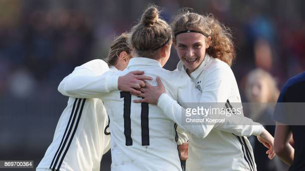 Franziska Kett of Germany celebrates the first goal with Lisanne Graewe and Annika Wohner during the International Friendly match between Germany U15...
