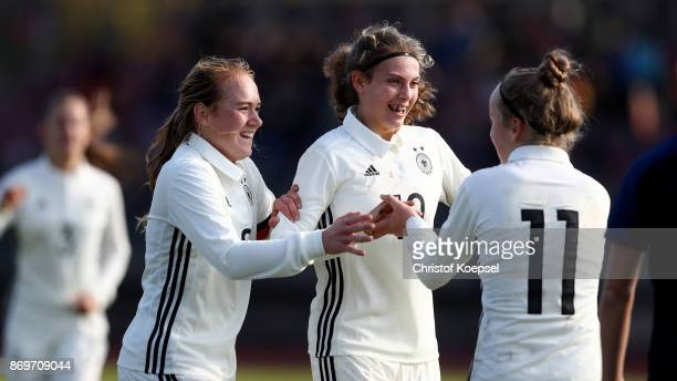 Franziska Kett of Germany celebrates the first goal with Lisanne Graewe and Annika Wohner of Germanyduring the International Friendly match between...