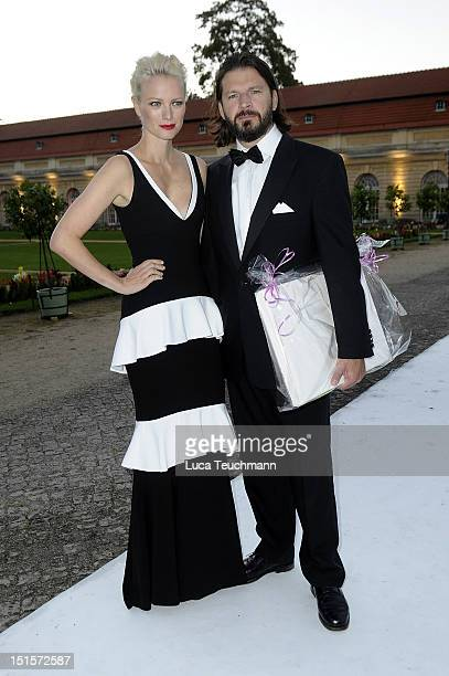 Franziska Knuppe and Christian Moestl arrive for the wedding party at at Charlottenburg Palace on September 8 2012 in Potsdam Germany