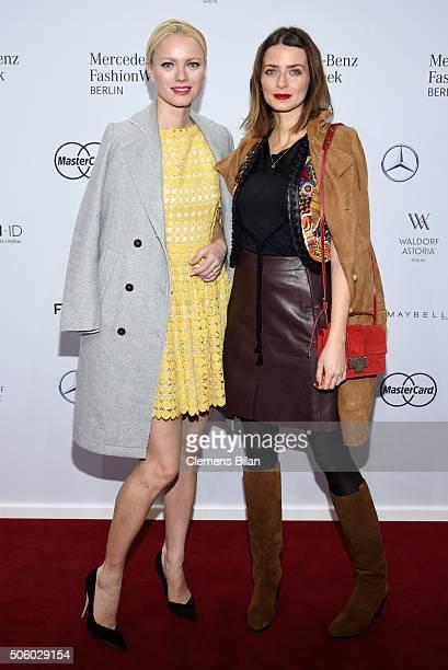 Franziska Knuppe and Eva Padberg attend the Dimitri show during the MercedesBenz Fashion Week Berlin Autumn/Winter 2016 at Brandenburg Gate on...