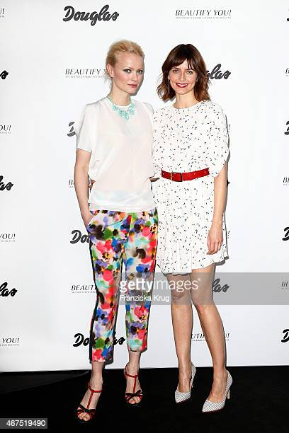 Franziska Knuppe and Eva Padberg attend the launch of the Douglas MakeUp line Beautify You on March 25 2015 in Hamburg Germany